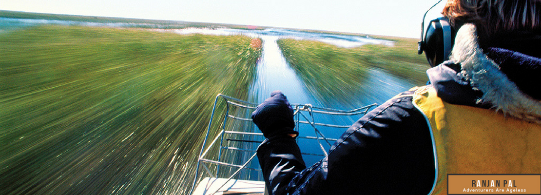 Gliding on an airboat through Shingle Creek requires headphones to block out thee roar of the propellers | RanjanPal.com